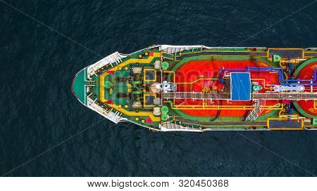 Red Tanker Ship Loading And Unloading Oil And Gas At Industrial Port, Business Import Export Petroch