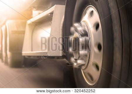 Truck Driving On Road. Truck Wheel Closeup, Transportation, Motion Blur