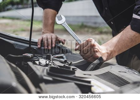 Services Car Engine Machine Concept, Automobile Mechanic Repairman Hands Repairing A Car Engine Auto