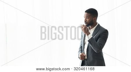 Pensive African American Businessman Enjoying Cityview From Window In Office, Panorama With Copy Spa