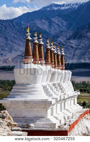 Chortens (Buddhist stupas) outside the Shey palace in Himalayas. Leh, Ladakh, India