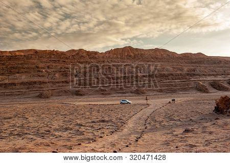 Car On Empty Parking Lot At Valle De La Luna Moon Valley, San Pedro De Atacama Chile. Wide View Of S