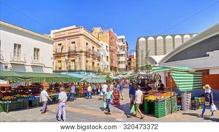 Algeciras, Spain - June 29, 2019. Locals Shopping In The Exterior Stalls Of The Algeciras Downtown M
