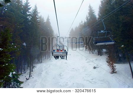 Chairlift In The Winter Mountains Running Through A Forest. Carpathian Mountains.