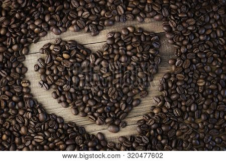 Coffee Beans Background. Organic Coffee. Roasted Coffee Beans. Coffee Beans On A Wooden Background I