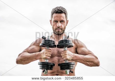 Gym Workout Concept. Dumbbell Exercise Gym. Muscular Man Exercising With Dumbbell. Price Of Greatnes