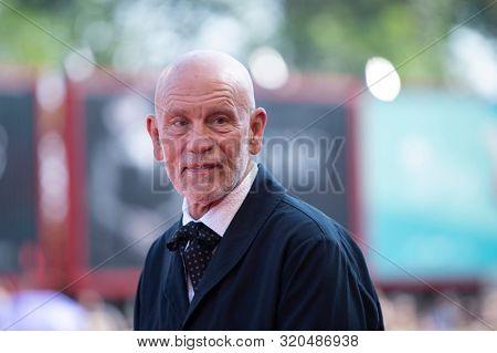 John Malkovich walks the red carpet ahead of