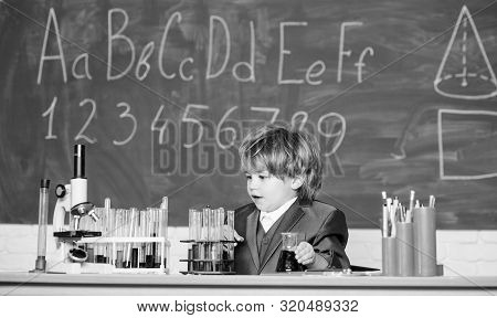 Educational Experiment. Happy Childhood. Boy Near Microscope And Test Tubes School Classroom. Knowle