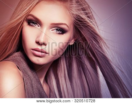 poster of Face of the Beautiful young woman with long straight  hair. Closeup portrait of a pretty girl over creative colored background