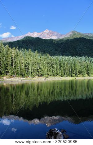Mt. Jefferson Towers Over Lake Pamelia In The August Sky.