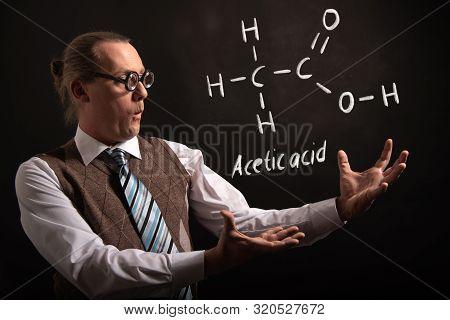 Professor presenting handdrawn chemical formula of acetaldehyde molecule poster