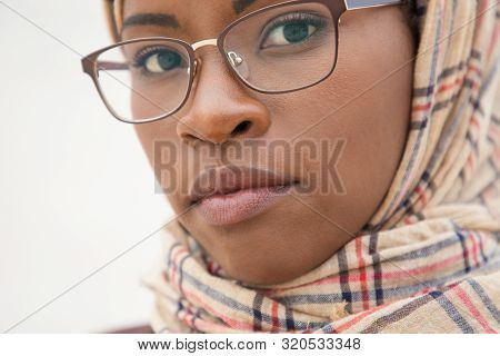 Serious Face Of Muslim Woman In Glasses Posing Outside. Closeup Of Smart Young Black Business Woman