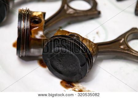 Two Metal Car Pistons In Poor Condition With Soot Oil Removed From Used Engine In A Deposit Of Oil L