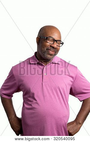 Portrait Of A Cheerful Smiling African American With Big Belly And Goofy Face, Purple Shirt And Blac