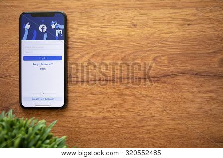 Anapa, Russia - August 1, 2019: Iphone X With Social Networking Service Facebook On The Screen And B