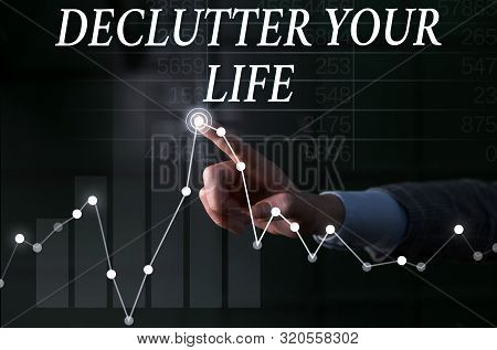 Text sign showing De Clutter Your Life. Conceptual photo remove unnecessary items from untidy or overcrowded places Lady presenting hand blue glow futuristic modern technology tech graph economy look. poster