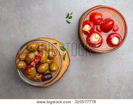 Italian Food Ingredients Background With Olives, Oil Red Stuffes With Cheese Bell Peppers