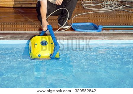 Pool Cleaner During His Work. Cleaning Robot For Cleaning The Botton Of Swimming Pools.  Automatic P