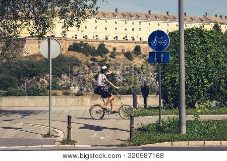 Woman Cycling In Novi Sad, Serbia 24.08.2019. Senior Woman Cycling On Sunny Summer Day. Senior Woman