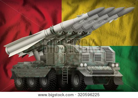 Tactical Short Range Ballistic Missile With Arctic Camouflage On The Guinea-bissau Flag Background.