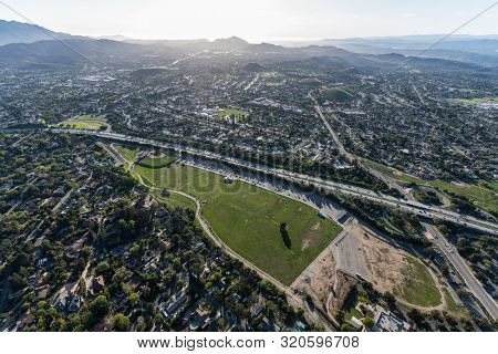 Aerial view of sports fields, homes and route 23 freeway near Los Angeles in suburban Thousand Oaks, California.