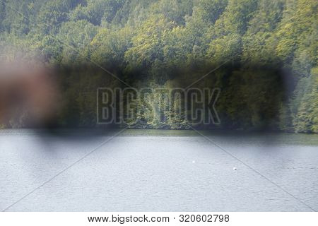 Blur, Greased Silhouette Of Black Glassed On The Background Of Forests And Lakes, The Background Of