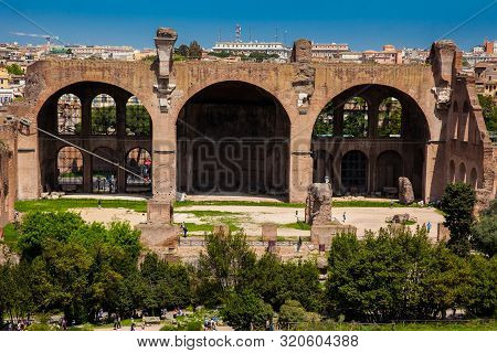 Rome, Italy - April, 2018: Tourists At The Basilica Of Maxentius And Constantine In The Roman Forum
