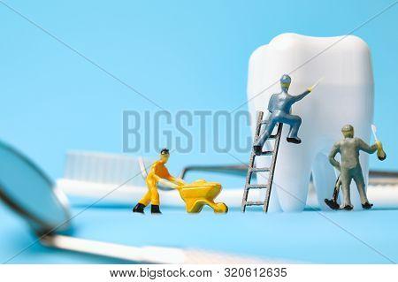 Dental Model And Dental Equipment On Grey Background, Concept Image Of Dental Background.