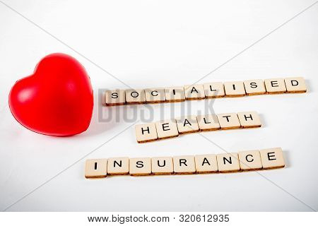 Healthcare Concept Showing A Heart And The Message Socialised Health Insurance