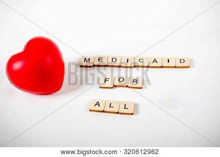 Healthcare Concept Showing A Heart And The Message Medicaid For All