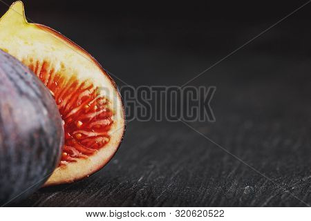 Figs On A Dark Background, Fig Flesh Close-up. Still Life From A Group Of Fig Fruits On A Black Subs