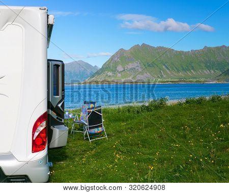 Camper Car Motor Home On Gimsoysand Sandy Beach In Summer. Camping On Ocean Shore. Lofoten Archipela