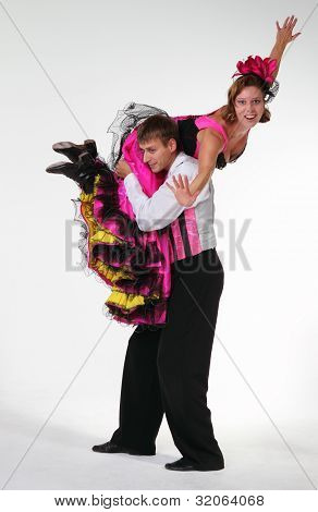 Couple Dancing Cancan In Studio