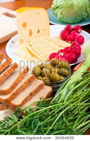 Emmenthal Cheese, Olives, Bread And Vegetable
