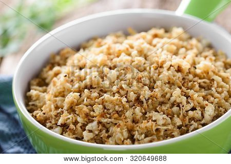 Fresh Homemade Roasted Or Fried Cauliflower Rice In Bowl (selective Focus, Focus One Third Into The