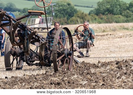 Haselbury Plucknett.somerset.united Kingdom.august 18th 2019.a Plough Is Being Pulled Across A Field