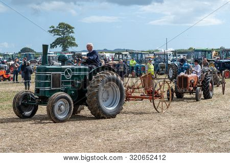 Haselbury Plucknett.somerset.united Kingdom.august 18th 2019.a Restored Field Marshal Tractor Is Bei