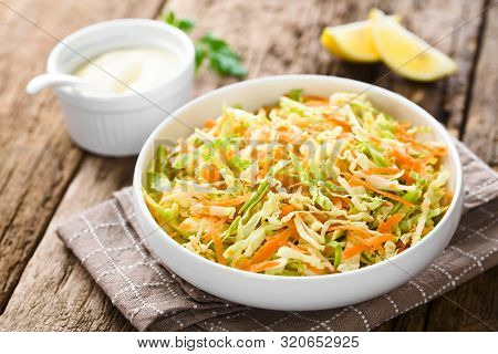 Coleslaw Made Of Freshly Shredded White Cabbage And Grated Carrot In Bowl, Homemade Mayonnaise-based