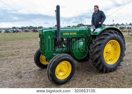 Haselbury Plucknett.somerset.united Kingdom.august 18th 2019.a Vintage John Deere Tractor Is Being D