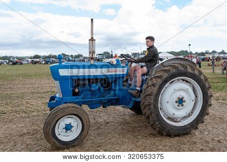 Haselbury Plucknett.somerset.united Kingdom.august 18th 2019.a Restored Vintage Ford 4000 Tractor Is
