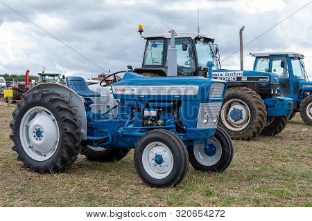 Haselbury Plucknett.somerset.united Kingdom.august 18th 2019.a Row Of Old Ford Tractors Are Parked I
