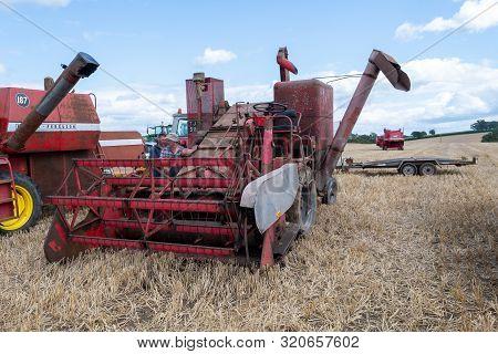 Haselbury Plucknett.somerset.united Kingdom.august 18th 2019.a Vintage Combine Harvester Is On Displ