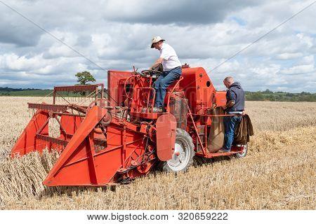 Haselbury Plucknett.somerset.united Kingdom.august 18th 2019.a Vintage Combine Harvester Is Harvesti