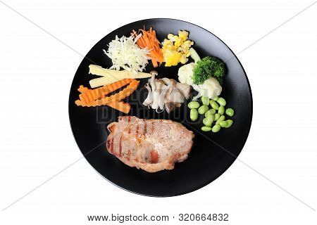 Homemade Cooking Of Pork Steak Served With Mixed Vegetable As Stream Carrot ,corn,green Bean,lettuce