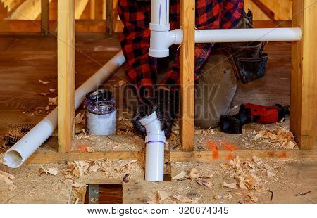 Plumber Putting Glue On A Pvc Drain Pipe In The House Construction