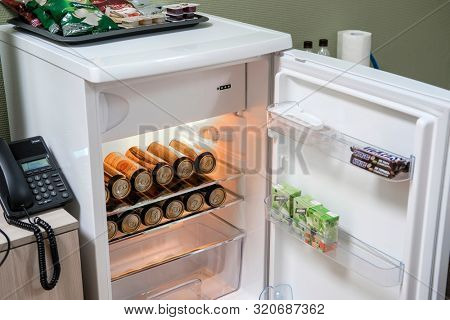 Mosocw region, Russia - August, 23, 2019: beer cans in the fridge in a hotel room in Moscow region, Russia