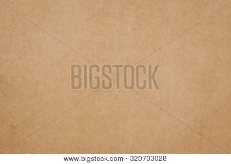 Old Paper Texture. Brown Parchment Surface. Yellow Packaging Background, Dirty Card Backdrop. Vintag
