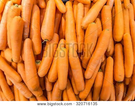 Organic Carrot. Texture Background Of Fresh Large Orange Carrots, Carrots Are Good For Health, Healt
