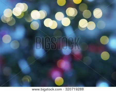 Christmas Tree With Defocused Lights And Star.