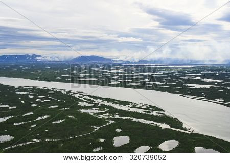 Tundra, Lakes And Rivers Amid Smoke And Pipes From The Norilsk Metallurgical Plant. Ecology Of The T